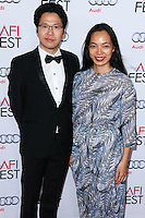 HOLLYWOOD, LOS ANGELES, CA, USA - NOVEMBER 12: Marcus Manh Cuong Vu, Diep Hoang Nguyen arrive at the AFI FEST 2014 - Special Tribute To Sophia Loren held at the Dolby Theatre on November 12, 2014 in Hollywood, Los Angeles, California, United States. (Photo by Xavier Collin/Celebrity Monitor)