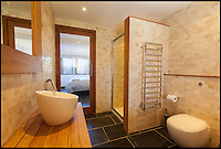 BNPS.co.uk (01202 558833)<br /> Pic: Jackson-Stops/BNPS<br /> <br /> ****Must use full byline****<br /> <br /> One of the three plush bathrooms.<br /> <br /> A stunning cliff-top house has grown into a 1.25 million pounds property after it was built on a disused allotment.<br /> <br /> Jamie and Zoe McLintock forked out &pound;80,000 for the overgrown plot of land eleven years ago because it was atop a cliff along Devon's craggy coastline.<br /> <br /> The enterprising couple spent a further &pound;600,000 and three years of their time building the beautiful five-bedroom pad.<br /> <br /> But they are now set to double their money after the incredible property went on the market for a whopping &pound;1.25 million with estate agents Jackson-Stops.<br /> <br /> The white-washed three-storey house is perched on top of 100ft cliffs overlooking Tunnels Beaches in Ilfracombe, a stretch of private Victorian beach owned by the couple since 2001.