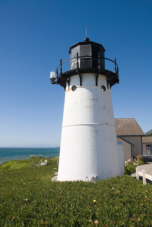 Montara Lighthouse, now a Youth Hostel, .San Mateo Coast of California, south of San Francisco.  Photo copyright Lee Foster, 510-549-2202, lee@fostertravel.com, www.fostertravel.com. Photo 419-31194