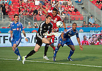 July 3, 2013: Montreal Impact goalkeeper Troy Perkins #1 catches a ball as Toronto FC midfielder Luis Silva #11 battles with Montreal Impact defender Matteo Ferrari #13 and Montreal Impact midfielder Jeb Brovsky #5 during an MLS game between Toronto FC and Montreal Impact at BMO Field in Toronto, Ontario Canada.<br /> The game ended in a 3-3 draw.