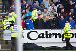 St Johnstone v Dundee.....02.01.13      SPL.Police remove a St Johnstone fan from the crowd after a smoke grenade was let off.Picture by Graeme Hart..Copyright Perthshire Picture Agency.Tel: 01738 623350  Mobile: 07990 594431