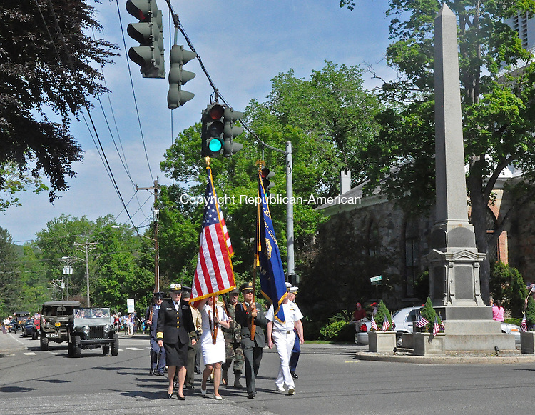 KENT, CT – 26 May 2014 - 052614LMW02 – Kent veterans pass by the Soldiers Monument, which is a memorial to those from Kent who fought in the Civil War, located at the main intersection of Routes 7 and 341. Lynn Mellis Worthington Republican-American