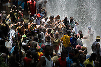 Haitian followers of Catholicism and Voodoo bathe in the waterfall during the annual religious pilgrimage in Saut d'Eau, Haiti, July 16, 2008. Every year in summer thousands of pilgrims from all over Haiti make the religious journey to the Saut d'Eau waterfall (100km north of Port-au-Prince). It is believed that 150 years ago the spirit of Virgin Mary (Our Lady of Mount Carmel) has appeared on a palm tree close to the waterfall. This place became a main pilgrimage site in Haiti since then. Haitians wearing only underwear perform a bathing and cleaning ritual under the 100-foot-high waterfall. Voodoo followers (many Haitians practise both voodoo and catholicism) hope that Erzulie Dantor, the Voodoo spirit of water, manifest itself and they get possessed for a short moment, touched by her presence.