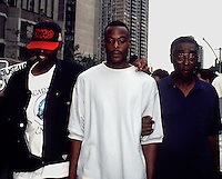 IN ADVANCE FOR 20TH ANNIVERSARY OF CROWN HEIGHTS RIOTS IN BROOKLYN, NY ON AUGUST 19, 1991. Lemrick Nelson (C) aided by supporters leaves Brooklyn Federal court in September 1995 during his trial for the murder of Yankel Rosenbaum in the 1991 Crown Heights riots. (© Richard B. Levine)