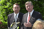 """United States Secretary of Health and Human Services Tommy Thompson, left, and Attorney General John Ashcroft, right, meet reporters at the White House following the Rose Garden event where U.S. President George W. Bush named John P. Walters  to be the """"Drug Czar"""" in the Rose Garden of the White House in Washington, D.C. on May 10, 2001..Credit: Ron Sachs / CNP"""