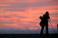 A photographer captures images of the sunset at Santa Monica beach on Friday, January 7, 2011.