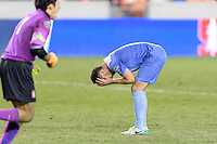 Houston, TX -  Friday, December 9, 2016: Alex Comsia (4) of the North Carolina Tar Heels is dismayed at missing the goal in the overtime shootout against the Stanford Cardinal  at the  NCAA Men's Soccer Semifinals at BBVA Compass Stadium.