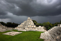 Great Acropolis, square base 530 feet wide and 25 feet high, with the Five-Floor Building rising from the summit and the House of the Moon on the right Puuc architectural style, Late Classic Period, 600 - 900 AD, Edzna, Campeche, Mexico. Picture by Manuel Cohen