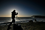 A landscape photographer prepares for a shot of Freshwater Bay on the isle of wight