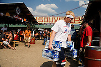 A worker transports beer to the bar at the Testicle Festival at the Rock Creek Lodge in Clinton, MT.  The Rock Creek Lodge in Clinton, MT, has hosted the annual Testicle Festival since the early 1980s.  The four day festival and party revolves around the consumption of so-called Rocky Mountain Oysters, which are deep-fried bull testicles.