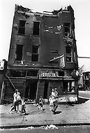 August 1971, Brooklyn, New York City, New York State, USA --- The long, hot summer of August 1971 exacerbated tensions in the black ghetto. Poor housing, tear down or burned building, poverty, unemployment and crime did not facilitate the poor inhabitants during the heatwave. --- Image by © JP Laffont