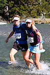 NELSON LAKES, NEW ZEALAND - APRIL 18:  Kent and Angela Wheeler cross the Travers River during the 2015 Alpine Lodge Loop The Lake trail run at Lake Rotoiti on April 18 16, 2015 in Nelson, New Zealand. (Photo by Marc Palmano/Shuttersport Limited)