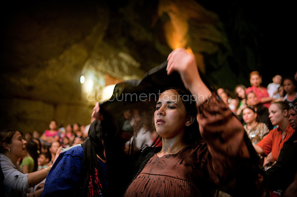 A Muslim woman covers her head with her veil just after Father Samaan has exorcised.<br /> <br />  copyright : Magali Corouge / Documentography