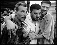 Abu Graibh penitentiary, near Baghdad, October 20, 2002.Tens of thousands of prisoners are amnistied by president Saddam Hussein and are released 2 hours after the official announcement..A released prisoner is met by his two brothers after 8 1/2 years of custody.