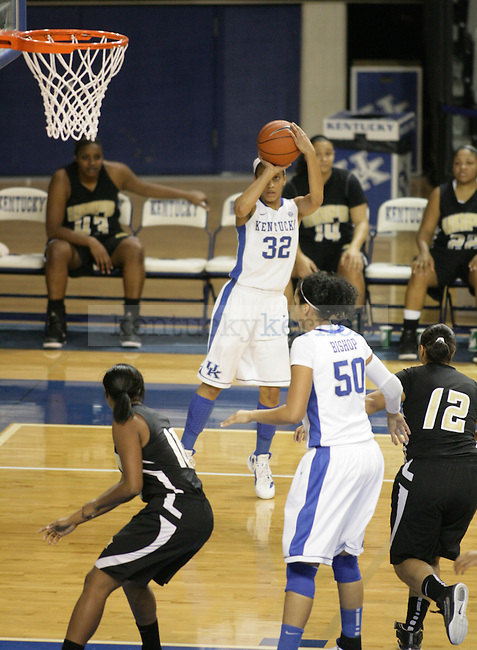 UK's Kastine Evans shoots a three-point shot against Arkansas Pine-Bluff at Memorial Coliseum on Sunday, Dec. 11, 2011. Photo by Scott Hannigan | Staff