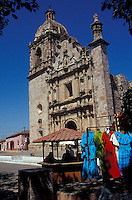 Clothing vendors in front of the 18th-century Church of San Sebastian in the Spanish colonial mining town of Concordia near Mazatlan, Sinaloa, Mexico
