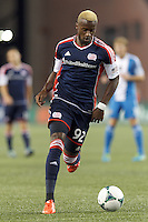 New England Revolution substitute forward Dimitry Imbongo (92) on the attack.  In a Major League Soccer (MLS) match, the New England Revolution (dark blue) defeated Philadelphia Union (light blue), 5-1, at Gillette Stadium on August 25, 2013.