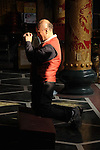 Bao-jhong Yi-min Temple, Kaohsiung -- Taoist believer praying at a temple in Taiwan.