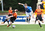 St Johnstone v Dundee United...19.04.14    SPFL<br /> David Wotherspoon is sent flying by Andrew Robertson<br /> Picture by Graeme Hart.<br /> Copyright Perthshire Picture Agency<br /> Tel: 01738 623350  Mobile: 07990 594431