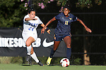 06 September 2013: West Virginia's Ashley Lawrence (CAN) (11) and Duke's Mollie Pathman (24). The Duke University Blue Devils hosted the West Virginia University Mountaineers at Koskinen Stadium in Durham, NC in a 2013 NCAA Division I Women's Soccer match. The game ended in a 1-1 tie after two overtimes.