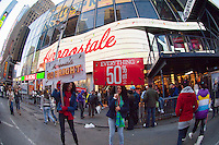Employees drum up business outside the Aeropostale store in Times Square in New York on Thanksgiving Day, Thursday, November 24, 2011. Many retailers are opening their doors on Thanksgiving or opening up for Black Friday the night before.(© Frances M. Roberts)