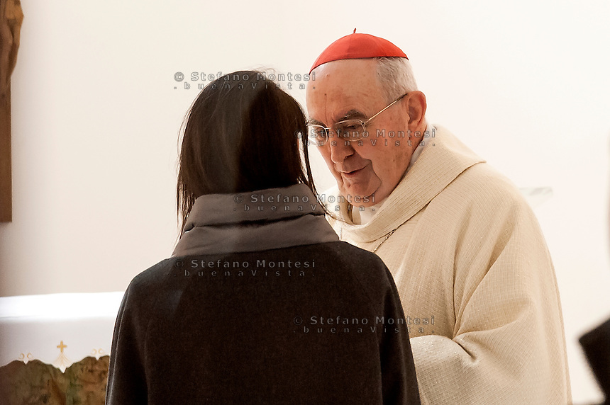 """ROME, ITALY -  DECEMBER 24:  Cardinal Pope's vicar for the Diocese of Rome, Agostino Vallini meets  Rome Mayor Virgina Raggi  during  Christmas Mass at the hostel """"Don Luigi Di Liegro"""" to Termini Station, with the  guests of Caritas on December 24, 2016 in Rome, Italy. (Photo by Stefano Montesi/Corbis via Getty Images)"""