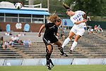 24 August 2012: Duke's Cassie Pecht (11) heads over Montreal's Virginie Levesque (CAN) (21). The Duke University Blue Devils defeated the University of Montreal Caribins 4-1 at Fetzer Field in Chapel Hill, North Carolina in an international women's collegiate friendly game.