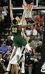 North Dakota State's Kory Brown (22) is called for a charging foul as he bowls over Gonzaga's Kevin Pangos (4) while going to the basket during the 2015 NCAA Division I Men's Basketball Championship's March 20, 2015 at the Key Arena in Seattle, Washington. Helping to defend is Domantas Sabonis (11).    ©2015. Jim Bryant Photo. ALL RIGHTS RESERVED.