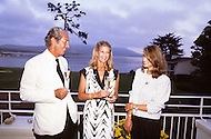 August 26th, 1984. Mr. Chandon, CEO of Moett and Chandon Champagne, with a bottle and talking to his wife and daughter.