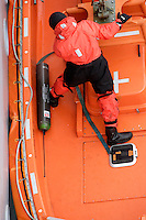 Researcher in RIB recovering Oceanographic buoy. The buoy had been circling in a Polar vortex at 1500 metres depth for over a year collecting  data. Greenland sea, North Atlantic