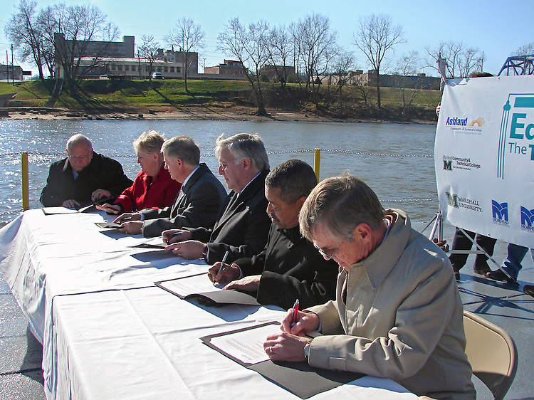 University Presidents Unite to Sign Memorandum of Understanding aboard barge on the Ohio River...Presidents in order from left to right..Dr. Michael Moore, Provost and Executive Vice President.Morehead State University..Dr. Rita Rice Morris, President.Shawnee State University..Dr. Gregory D. Adkins, President.Ashland Community and Technical College..Dr. Stephen Kopp, President.Marshall University..Dr. Roderick J. McDavis, President.Ohio University..Dr. Herman Koby, Interim Dean,.Rio Grande Community College..Dr. Robert Hayes, Interim Dean.Marshall Community and Technical College..I am sending a summary of the Educate the Tri-State event held today. ..Presidents and representatives from seven universities in Ohio, West Virginia and Kentucky were present as part of the Educate the Tri-State initiative to work together to offer students easier access to degree programs and other information. ..The luncheon was held at Bellefonte Country Club in Ashland, Kentucky with each university president giving remarks on working together to better educate the residents of the area...A website designed to increase awareness of the educational opportunities available within the Tri-State area was demonstrated by Dr. Charles P. Bird, Vice President, University Outreach and Regional Campuses. The intended audience for the website will be prospective students, parents and guidance counselors. The website www.educatethetristate.com is in its initial stages and will be updated as the project continues. ..Immediately following the luncheon presentation, the event moved to the 15th Street Ashland Boat dock to board a barge provided by Marathon Petroleum. As the barge cruised the Ohio River, which connects all three states, each President signed a copy of the Memorandum of Understanding. The document was drafted by Dr. Charles P. Bird. (if you need a copy, please let me know. You may want to interview Charlie as well)..WSAZ Channel 3 and various newspapers covered the event. The event will