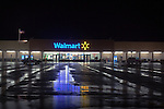 The Wal-Mart parking lot in Rochelle, IL is wet with recent rain puddles, shortly after a large storm has passed over the area.