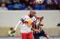 Thierry Henry (14) of the New York Red Bulls goes up for a header with Carlos Bocanegra (3) of Chivas USA. The New York Red Bulls and Chivas USA played to a 1-1 tie during a Major League Soccer (MLS) match at Red Bull Arena in Harrison, NJ, on March 30, 2014.