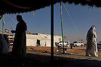 Cool shade of a dark tent in the hot sun at the Mohamed Khamisi compound.