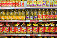 Cooking oils in supermarket, China. The Chinese use a lot of edible oil and find it an expensive item.