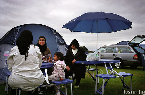 """British Muslims camp out at the four-day """"Living Islam"""" festival in northern England in July 2005.....The event, attended by thousands of mainly Pakistani Muslims across the UK, takes place in the Showground of Lincoln, one of England's great cathedral cities.....The event was organised by the Islamic Society of Britain and takes place co-incidentally days after the London bombings by purported Islamic extremists. Organisers said the gathering was a symbol of Muslims celebrating the true meaning of Islam.....There were activities for the family including music, entertainment, sports and speeches. .."""