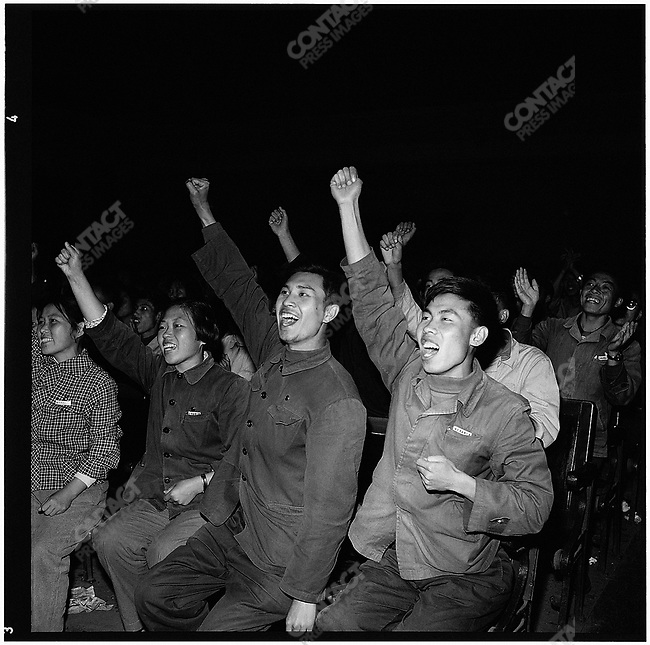 During a screening of the documentary film Chairman Mao, The Red Sun in Our Hearts, students hail each of Mao's appearances. Heilongjiang province, 23 July 1969.