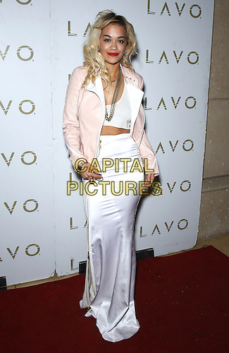 Rita Ora .hosts Stereo Saturdays at LAVO Nightclub inside the Palazzo Las Vegas, Las Vegas, Nevada, USA, .28 July 2012..full length pink leather jacket white long maxi skirt midriff  crop cropped top.CAP/ADM/MJT.&copy; MJT/AdMedia/Capital Pictures.