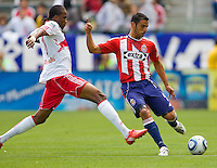 NY RedBulls forward Macoumba Kendji (10) defends against Chivas USA defender Michael Umana (4). Chivas USA defeated the Red Bulls of New York 2-0 at Home Depot Center stadium in Carson, California April 10, 2010.  .
