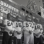 Pittsburgh PA:  Pittsburgh Steelers posing for a Public Relations photo shoot at Forbes Field.  Len Dawson #16, Ted Marchibroda #18, Billy Wells #24 & Ed Beatty #57 - the Oakland section of Pittsburgh 1957