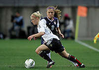 US's Kristie Mewis fights for the ball with Germany's Leonie Maier during their Algarve Women's Cup soccer match at Algarve stadium in Faro, March 13, 2013.  .Paulo Cordeiro/ISI