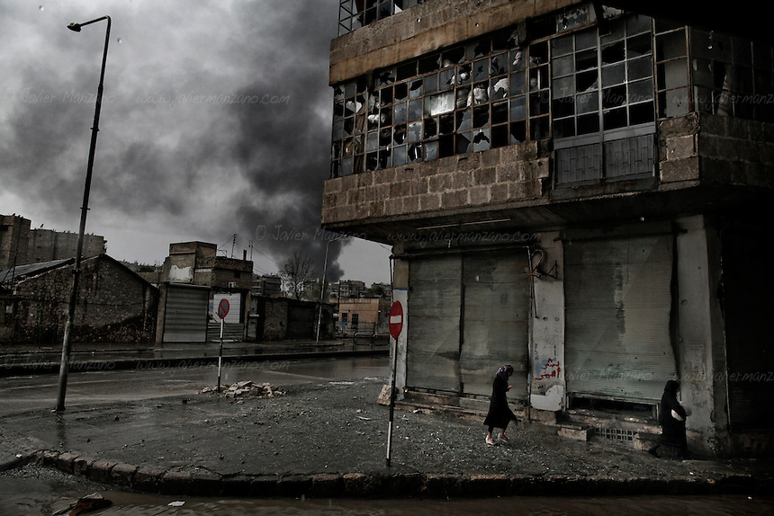 Smoke rises from a gasoline station in the Al-Arqoob neighborhood of central Aleppo after receiving a mortar on October 25, 2012...© Javier Manzano............................