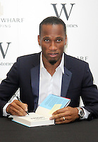 NOV 25 Didier Drogba signs copies of his book 'Commitment' at Waterstones