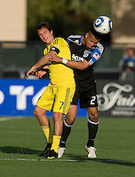 Jason Hernandez of Earthquakes fights for the ball against Guillermo Barros Schelotto of the Crew during the first half of the game at Buck Shaw Stadium in Santa Clara, California.  San Jose Earthquakes tied Columbus Crew, 2-2.