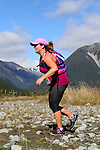 NELSON LAKES, NEW ZEALAND - APRIL 18:  Peggy Storer crosses the Travers River during the 2015 Alpine Lodge Loop The Lake trail run at Lake Rotoiti on April 18 16, 2015 in Nelson, New Zealand. (Photo by Marc Palmano/Shuttersport Limited)