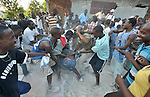 A distribution of food, tents and other emergency supplies dissolved into chaos when a group of men from a neighboring village invaded a January 30 distribution organized by the Lutheran World Federation, a member of the ACT Alliance, in the village of Gressier outside of Port-au-Prince, Haiti. A police woman fired two shots into the air, motivating the crowd to flee. A January 12 earthquake ravaged the Caribbean nation, leaving hundreds of thousands hungry and increasingly frustrated and desperate.