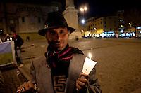 Roma 27 Gennaio 2011.Giornata della Memoria.Fiaccolata in ricordo perenne degli Stermini dimenticati dei Rom/Sinti, degli omosessuali, dei disabili. Da Piazza dell'Esquilino, fino alla Lapide sul Porrajmos e la Shoah, in Via degli Zingari 54..Rome, January 27, 2010.Memorial Day.Candlelight vigil in memory perennial forgotten extermination of the Roma / Sinti, homosexuals, disabled. Piazza Esquilino, to the plaque on Porrajmos and the Holocaust, in Via degli Zingari 54