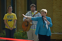 NWA Democrat-Gazette/BEN GOFF @NWABENGOFF<br /> Anita Turner (from right), Northside Elementary principal, speaks as the school's music teacher Kyle Schoeller and Brooke Price, a 5th grade teacher, look on Monday, May 15, 2017 during a ribbon-cutting for the new outdoor classroom at Northside Elementary School in Rogers. The school took the oportunity to thank the Rogers Public Education Foundation and local businesses including Lowe's Home Improvement, Milestone Construction Company and Gall Excavation Inc. which made the project possible. The outdoor classroom was complemented by raised planting beds and benches made by local Eagle Scouts, and a butterfly garden built by teachers.