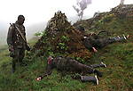 A Colombian soldier looks at the bodies of fellow soldiers that were killed in combat by FARC rebels just outside of Gutierrez. Thirty-six soldiers were killed in the fighting. Over 40,000 people have been killed in Colombia's conflict over the last ten years. (Photo/Scott Dalton)