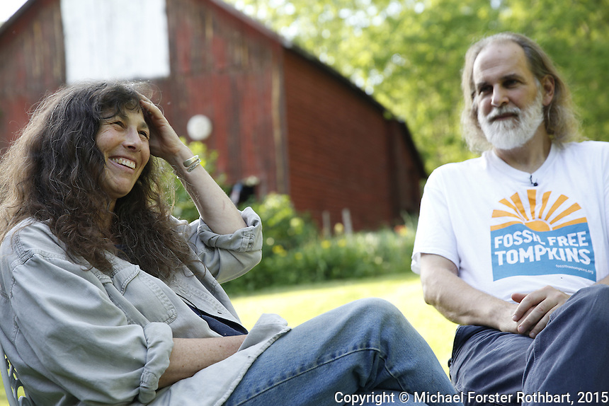 Karen Edelstein and Joe Wetmore are residents of Lansing, NY. Edelstein, a science educator, works with the FracTracker Alliance, and Wetmore owns Autumn Leaves Bookstore in Ithaca. Both are active members of Fossil Free Tompkins. a local environmental group in Ithaca, NY, working politically across Tompkins county to reduce dependence on fossil fuels. Their work includes political action against new fossil fuel infrastructure such as proposed conversion of the Cayuga Power Plant in Lansing to burn natural gas, the Crestwood Storage Facility in Seneca Lake and new pipelines. The group advocates instead for increase of renewable energy construction including the Black Oak Wind Farm in Enfield and solar installations. <br /> &copy; Michael Forster Rothbart Photography<br /> www.mfrphoto.com &bull; 607-267-4893<br /> 34 Spruce St, Oneonta, NY 13820<br /> 86 Three Mile Pond Rd, Vassalboro, ME 04989<br /> info@mfrphoto.com<br /> Photo by: Michael Forster Rothbart<br /> Date:  6/13/2015<br /> File#:  Canon &mdash; Canon EOS 5D Mark III digital camera frame A07927